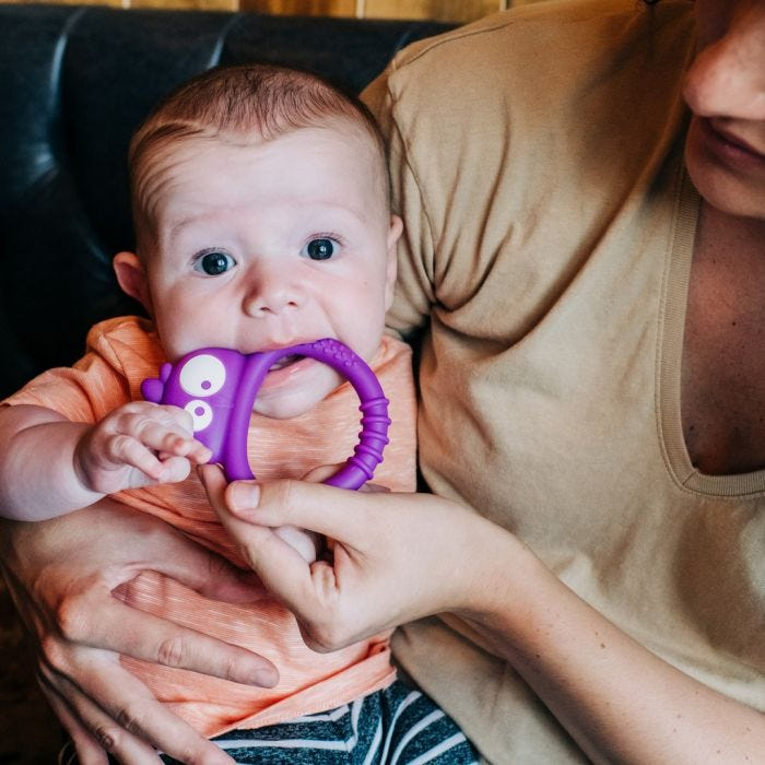 baby holding Kalani Mini Sensory Teething Toy