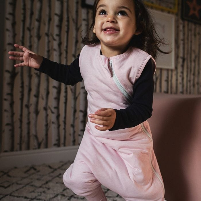 Baby running in pink steppee