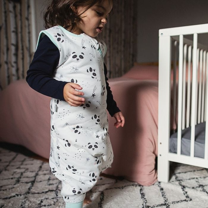 Child with long brown hair wearing The Original Grobag Little Pip Steppee walking around bedroom