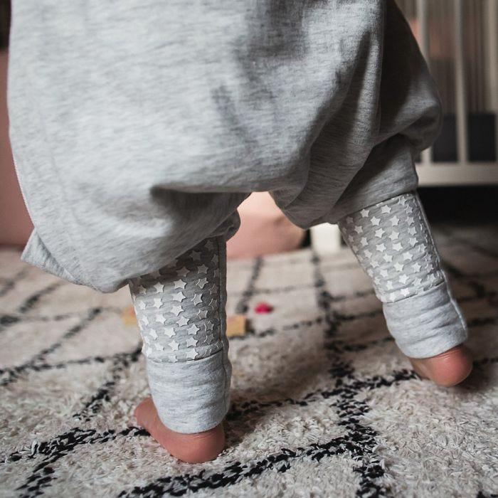 Baby feet in grey steppee