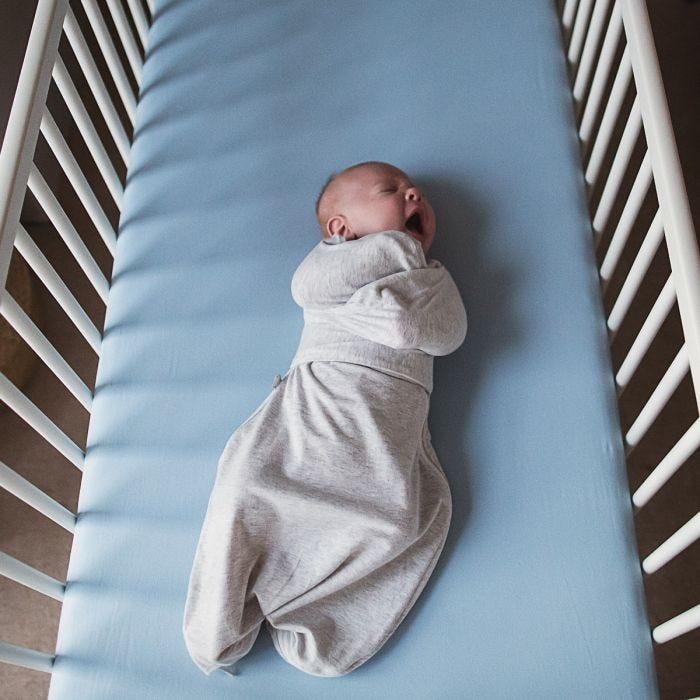 Baby sleeping in Grey Marl Swaddle Wrap