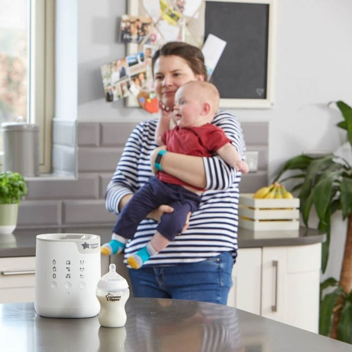 3-in-1 Advanced Electric Bottle and Pouch Warmer with mum and baby in background
