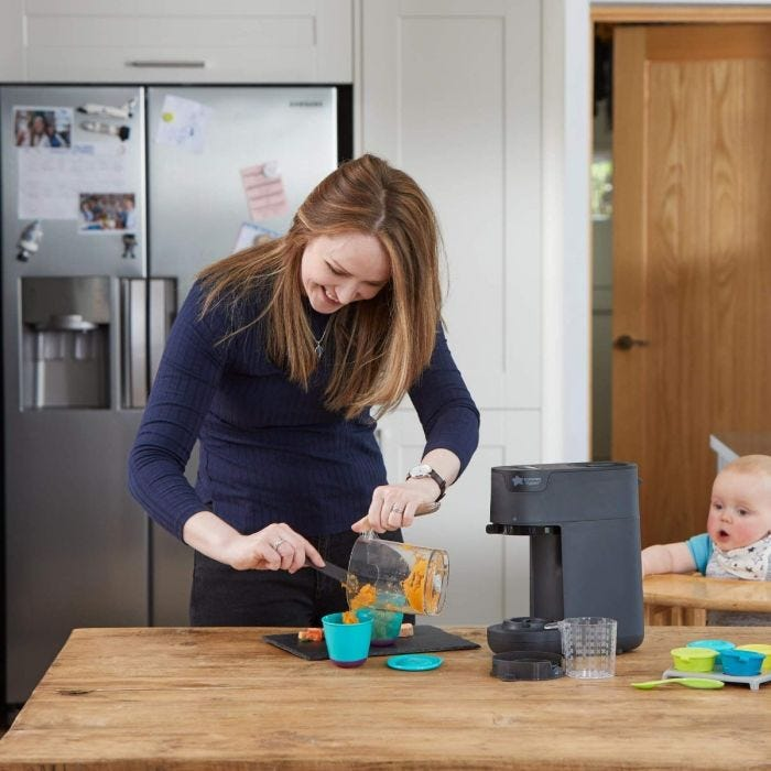 mum using quick cook baby food maker (black)