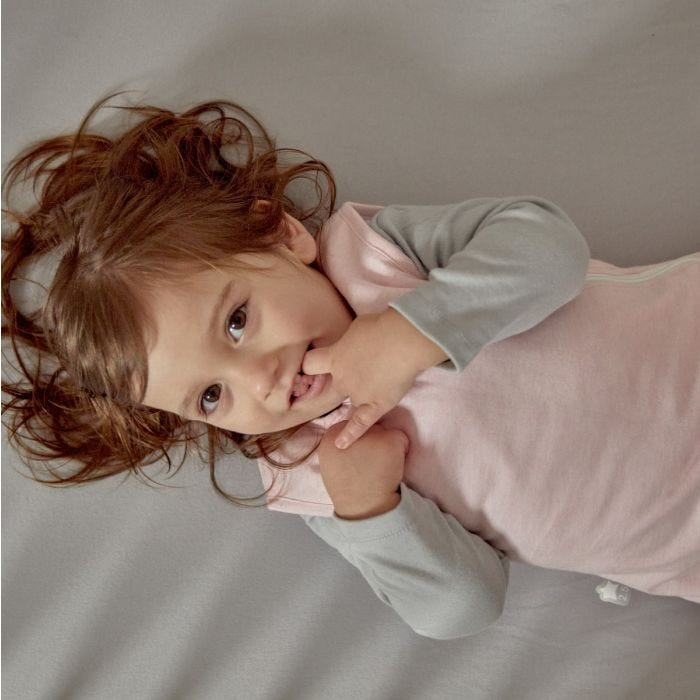 Child wearing The Original Grobag Pink Marl Sleepbag