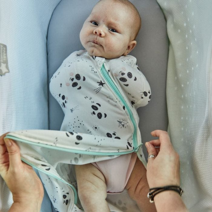 baby being changed using the 2 way zip on the The Original Grobag Little Pip Easy Swaddle
