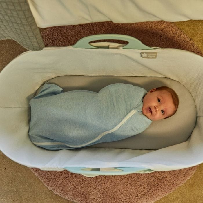 Baby swaddleed with The Original Grobag Blue Marl Easy Swaddle lying in cot