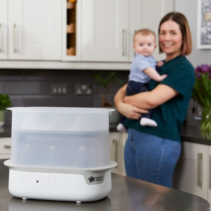 Mum and baby with electric steriliser