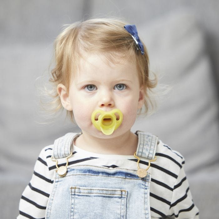 child holding Ultra-light Silicone Pacifier