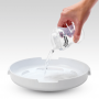 pouring-water-from-botte-into-micro-steam-steriliser